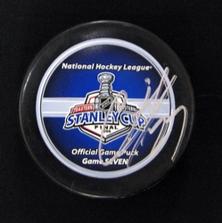 Adams Signed Puck Auction